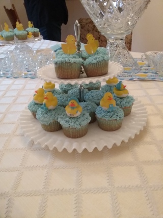 An antique milk glass cake stand, simple and lovely, displayed the ducky cupcakes.